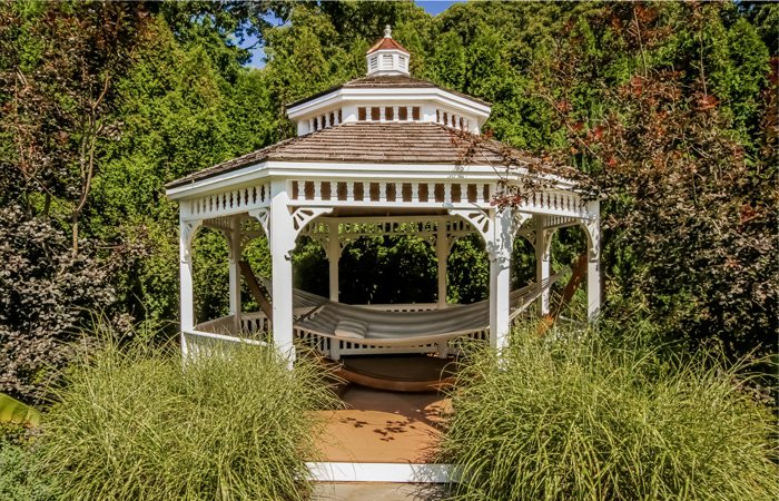 A gazebo surrounded by trees