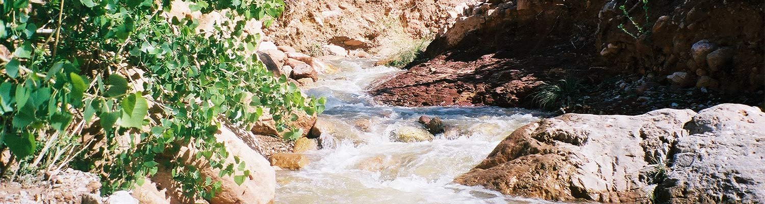 A flowing river between canyon walls