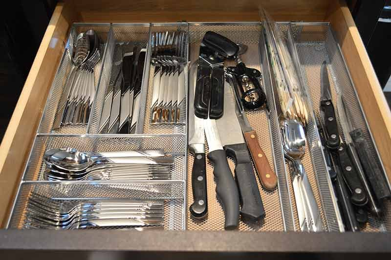 A drawer of utensils