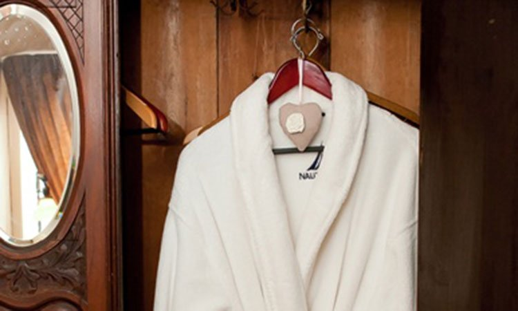 A bathrobe in a closet