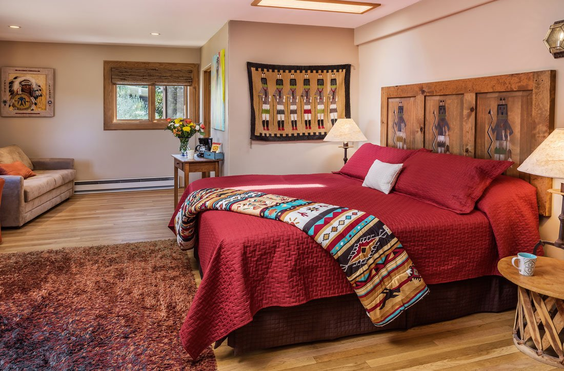 spacious room with large bed and Native American art