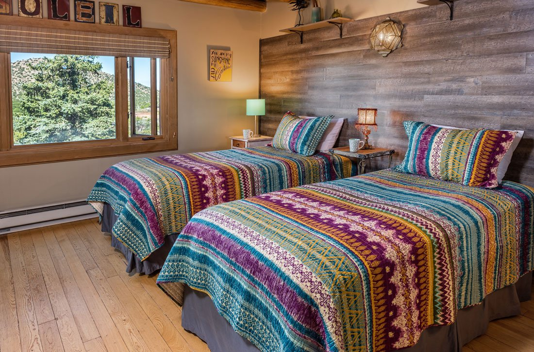 two twin beds with turquoise bedding