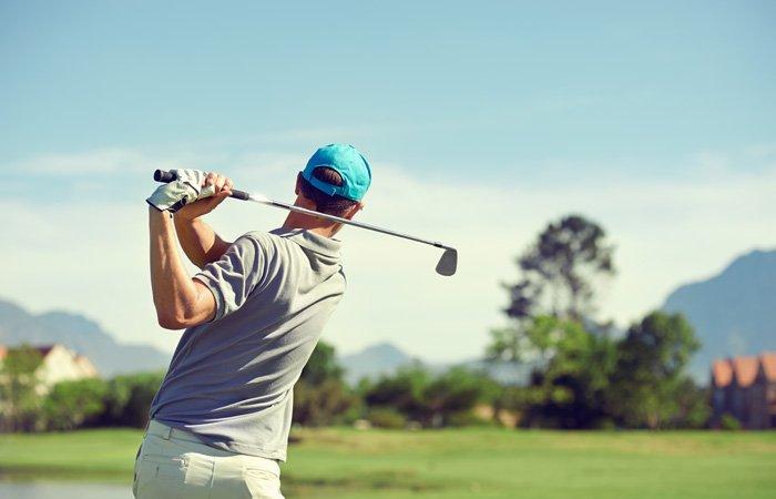 A man golfing