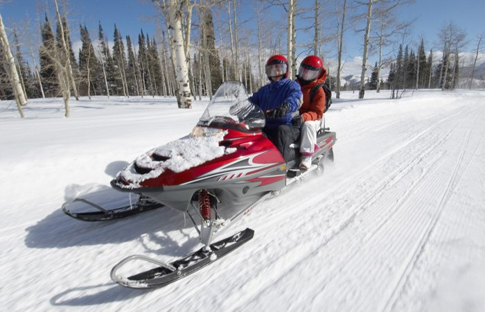 Two people on a snowmobile