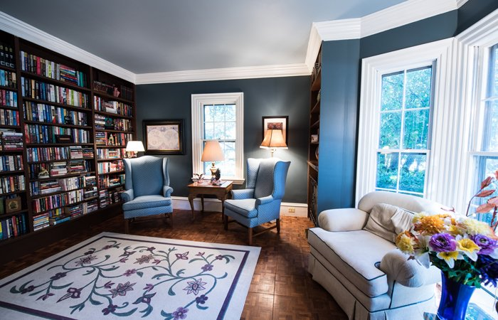A sunlit library room