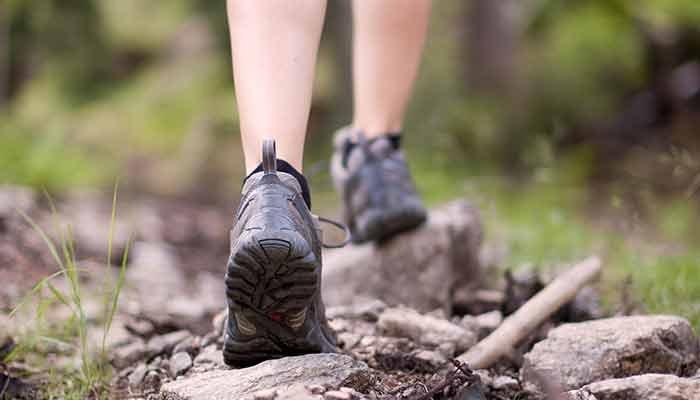 Feet walking in hiking boots
