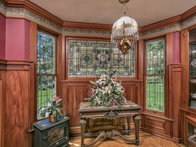 A room with stained glass windows and a chandelier