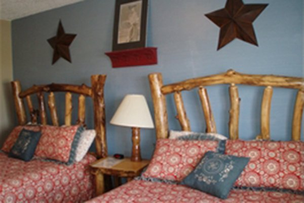 Log frame beds in bedroom