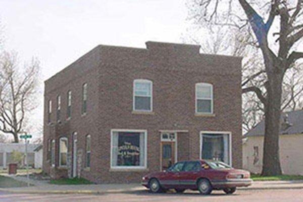 Stone building on corner of street