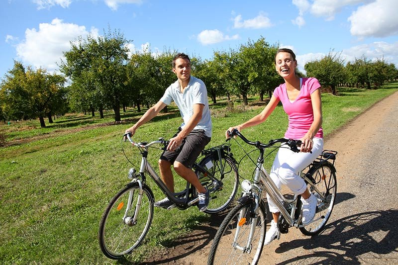 a couple on bikes on a path