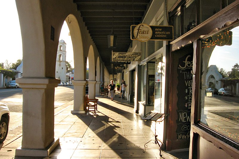 A covered walkway with pillars