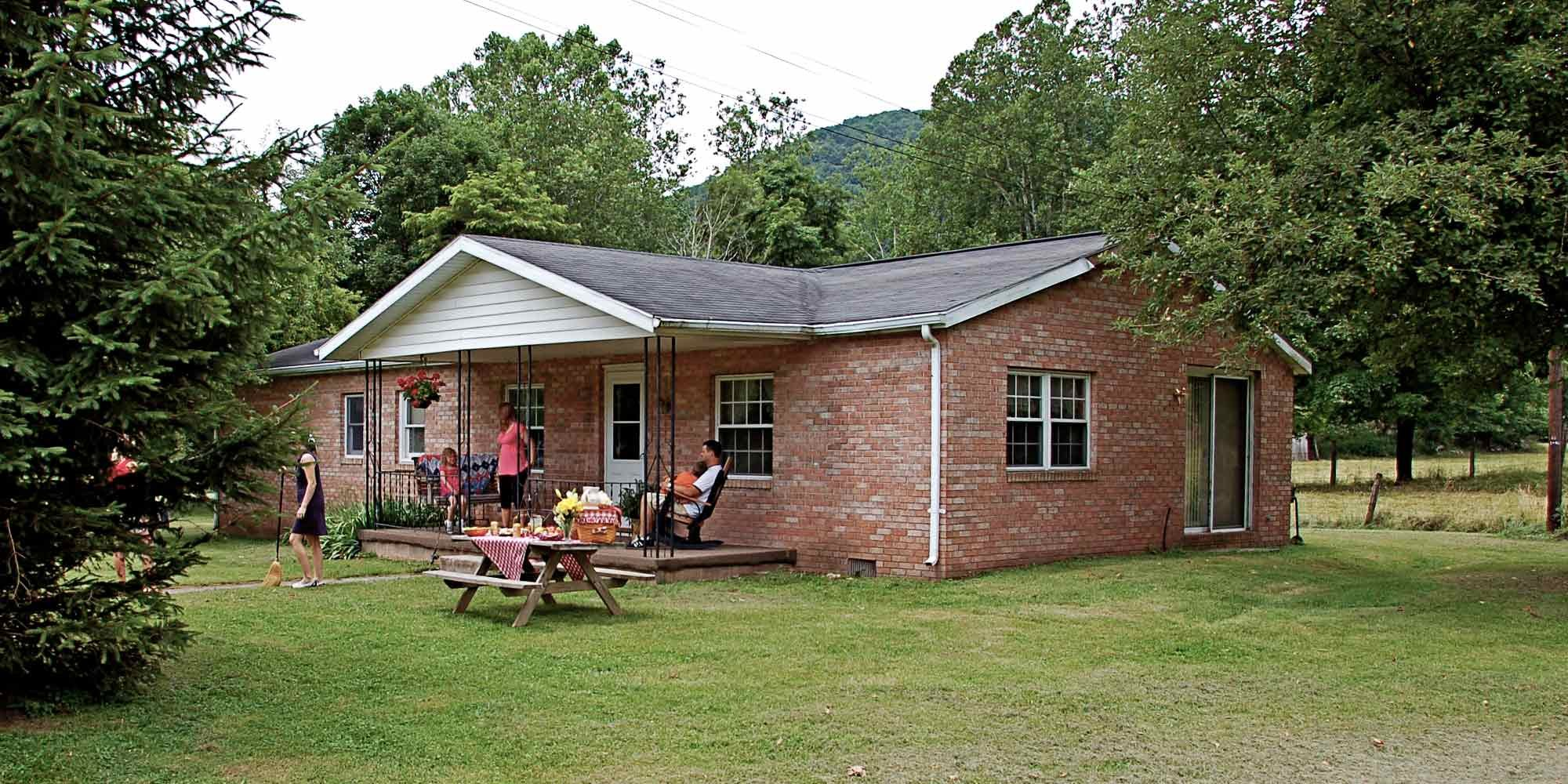 Brick home with porch and picnic table
