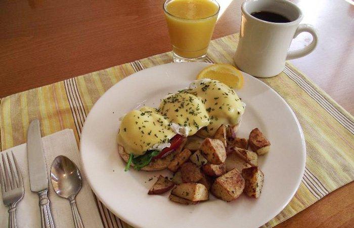 Ipswich Inn Breakfast eggs benedict and potatoes orange juice coffee