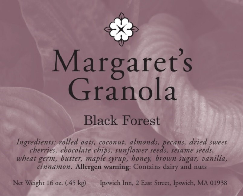 Margaret's Granola original. Ingredients: rolled oats, coconut, almonds, pecans, dried sweet cherries, chocolate chips, sunflower seeds, sesame seeds, wheat germ, butter, maple syrup, honey, brown sugar, vanilla, cinnamon. Allergen warning: contains dairy and nuts