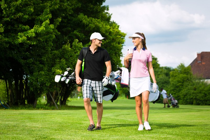 Bass and Baskets man and woman on golf course