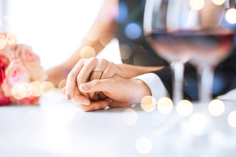 The Great Tree Inn Bed and Breakfast packages bride and groom holding hands