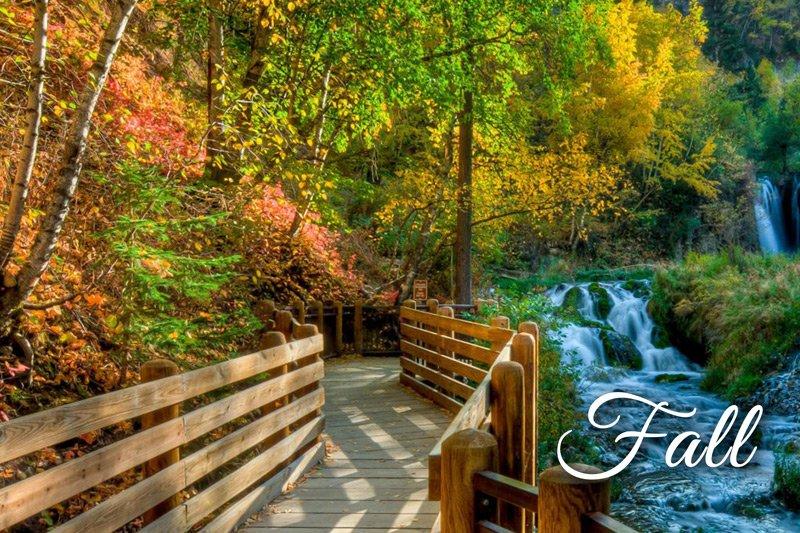 Summer Creek Inn Fall attractions bridge next to river