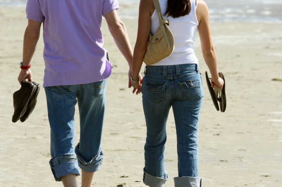 Couple at the Beach Holding Hands