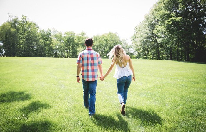 A couple walking through a field