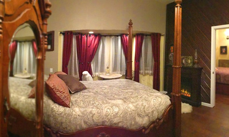 4-post bed and fireplace