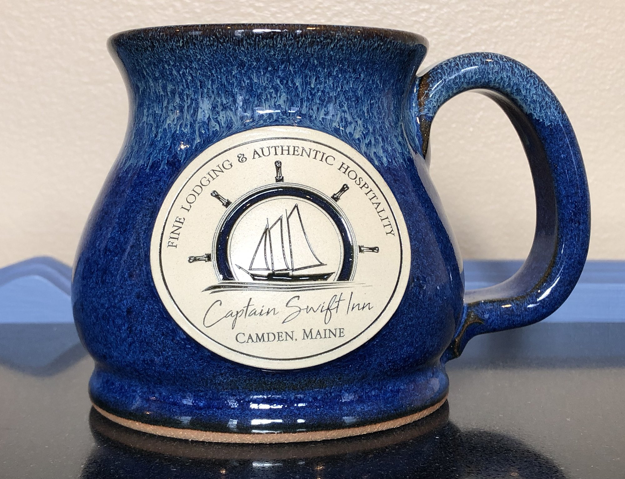 blue mug with logo