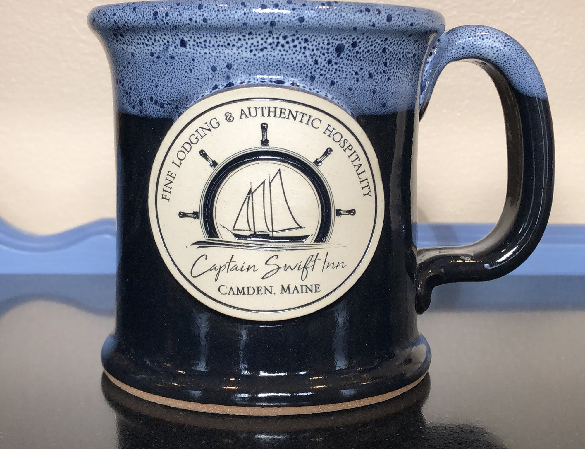 tall blue mug with logo