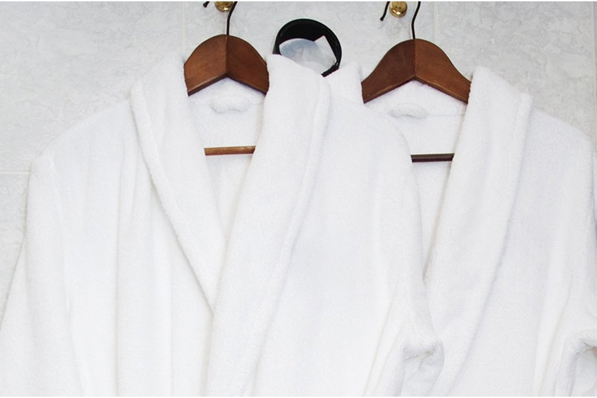white robe hanging on bathroom door