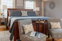 bed with wood headboard and blue bedspread