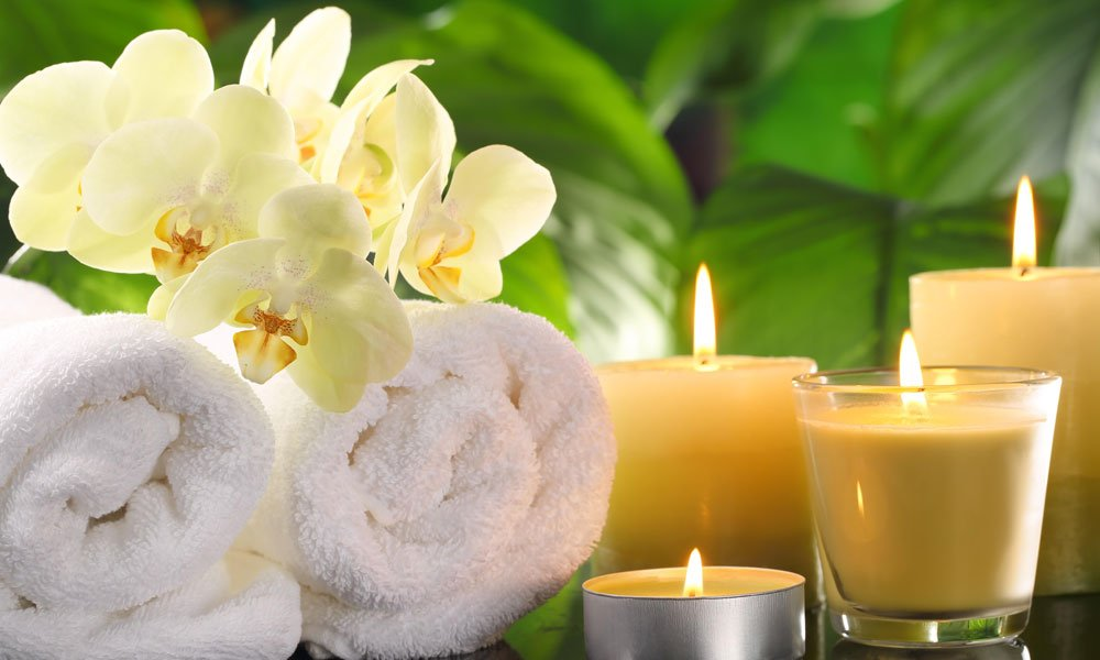 towels, candles, and orchid blossoms