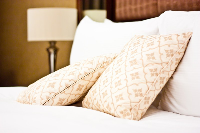 Captain Swift Event Packages pillows on bed
