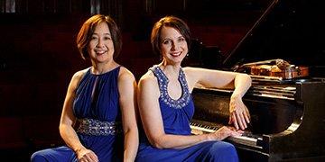 two women in formal blue dresses