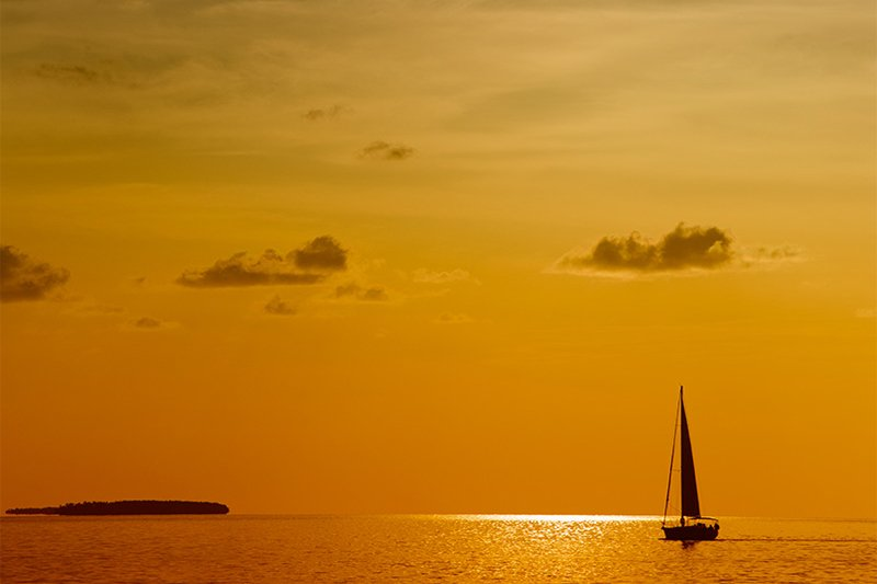 a sailboat in sunset