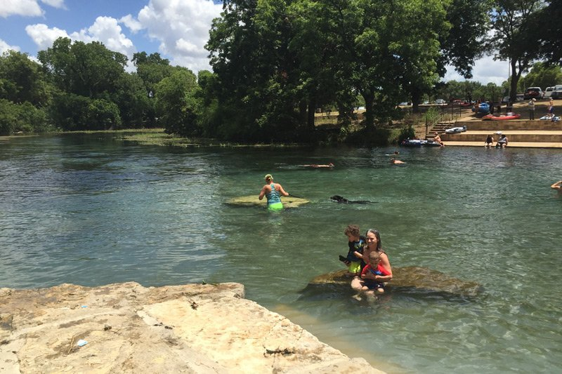 people swimming in a river