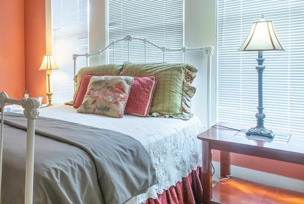 Queen bed with lamp