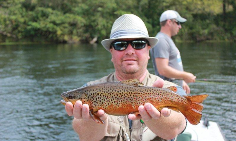 PJ's Lodge Adventures man holding trout