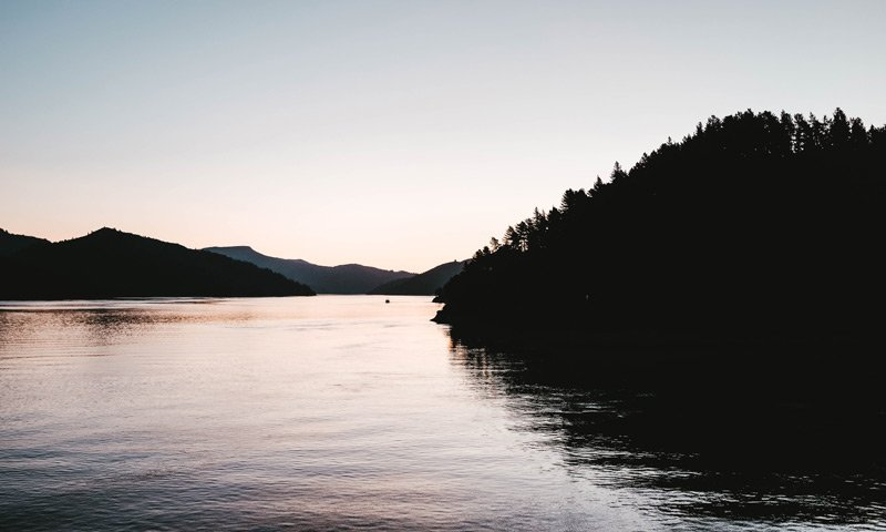 PJ's Lodge Adventures lake at sunset