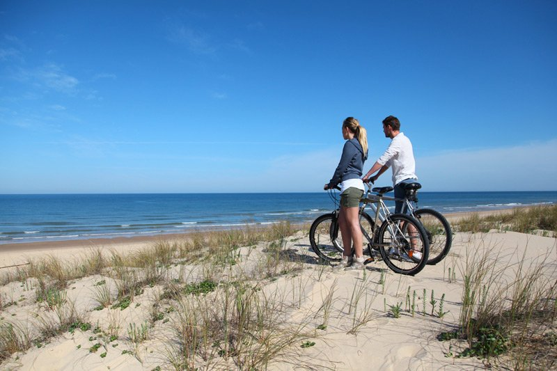 Spouter Inn Maine man and woman biking beach
