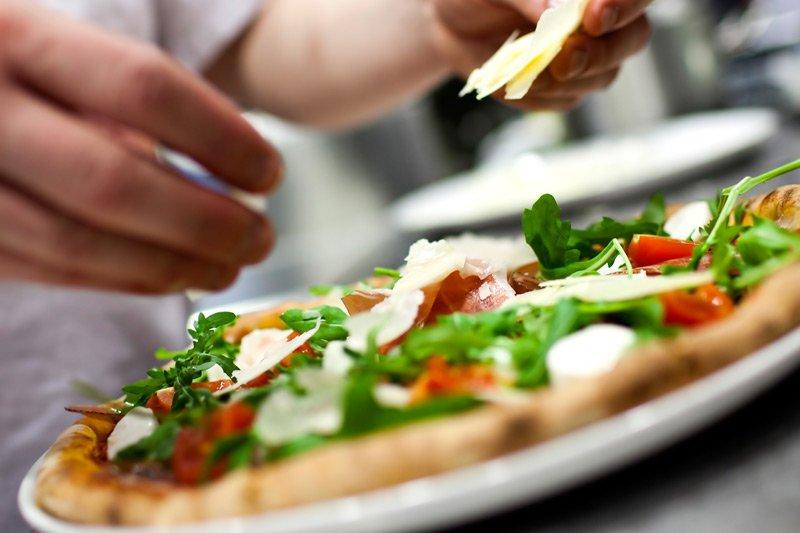 Spouter Inn Maine person preparing pizza