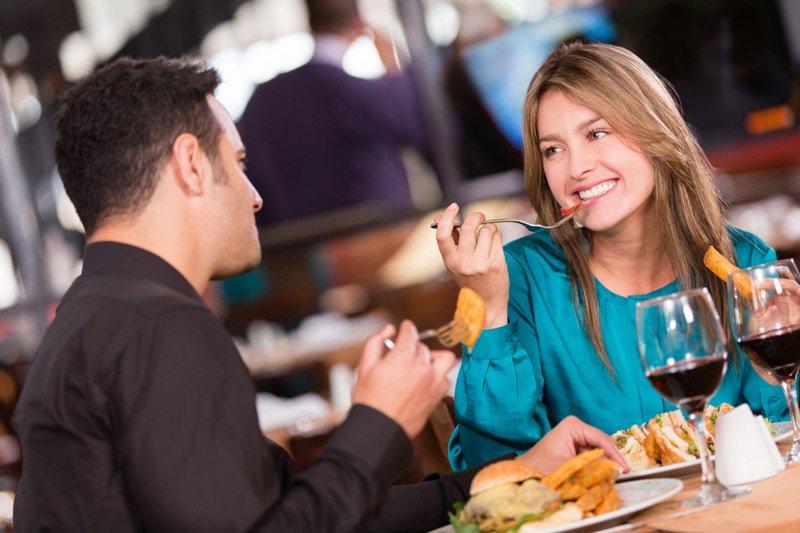 Spouter Inn Maine man and woman eating dinner at restaurant
