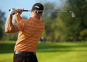 Golfer golfing in a field