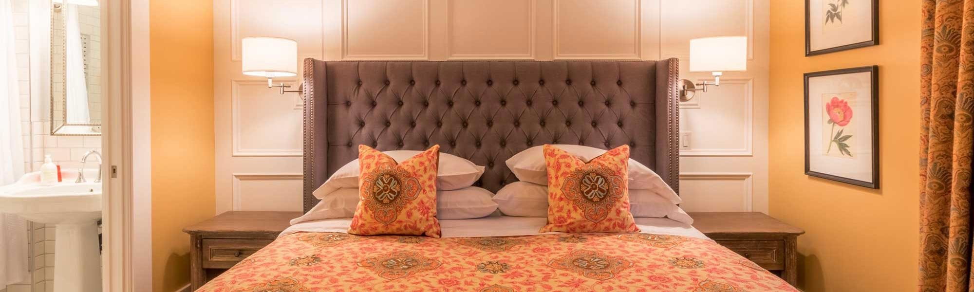 Orange Bed with Decorative Pillows
