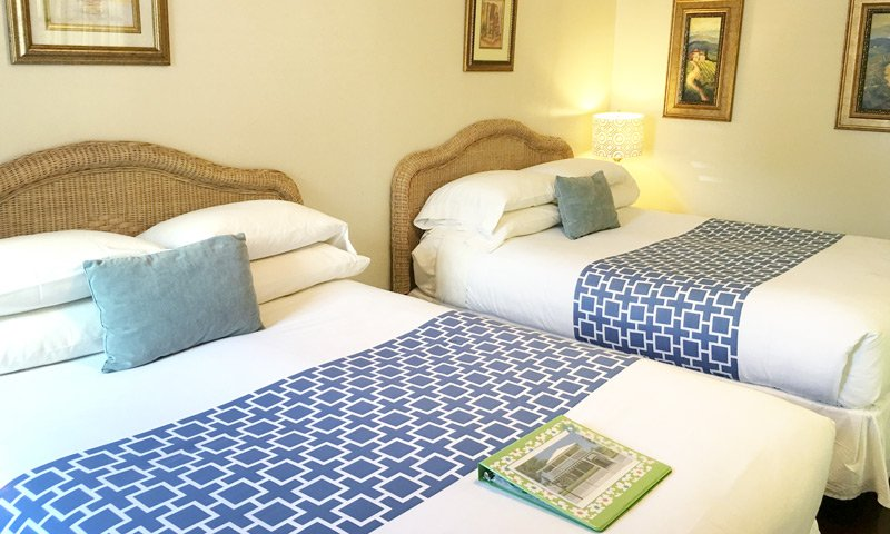 two beds with blue highlights