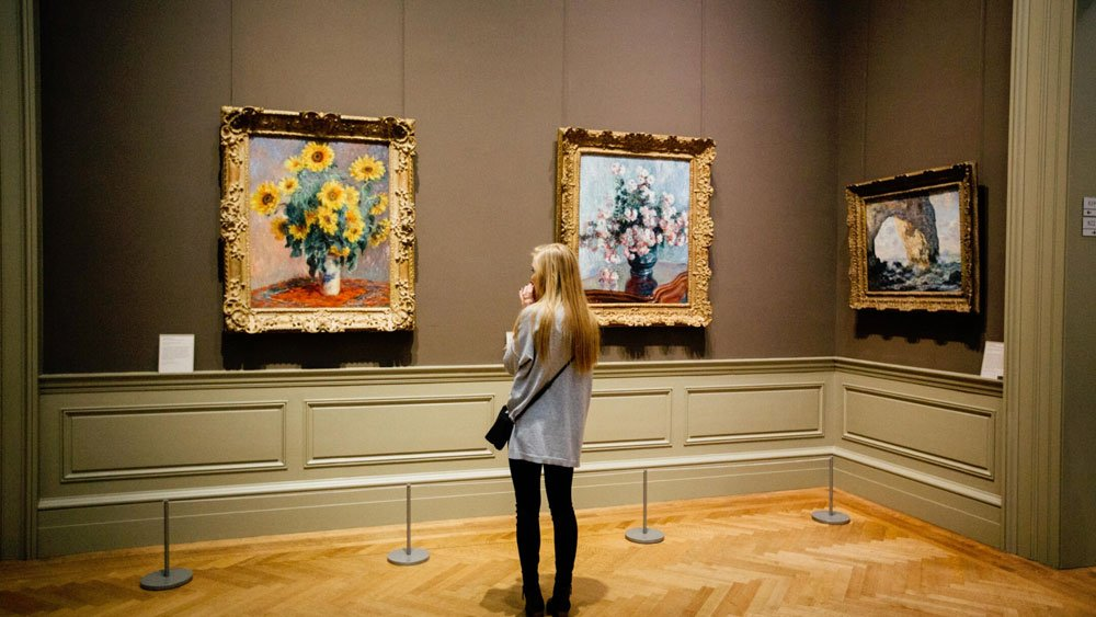 Girl admiring a painting
