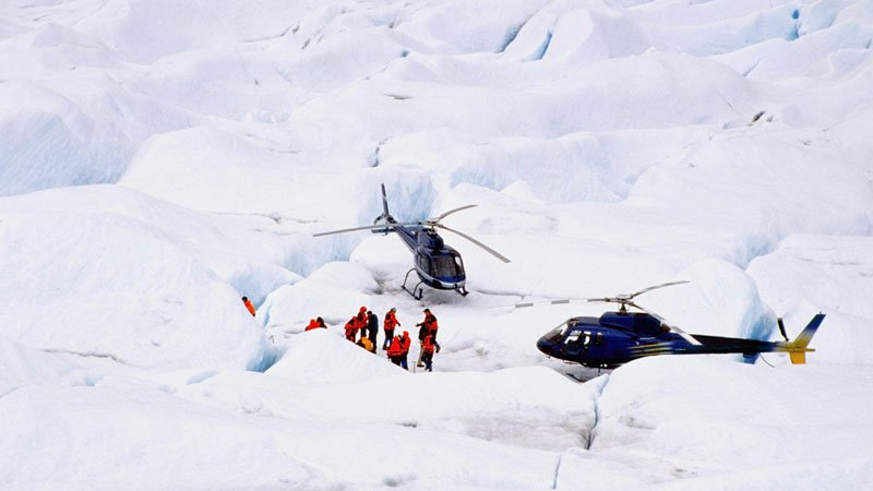 Birdseye view of Helicopter landed in snow