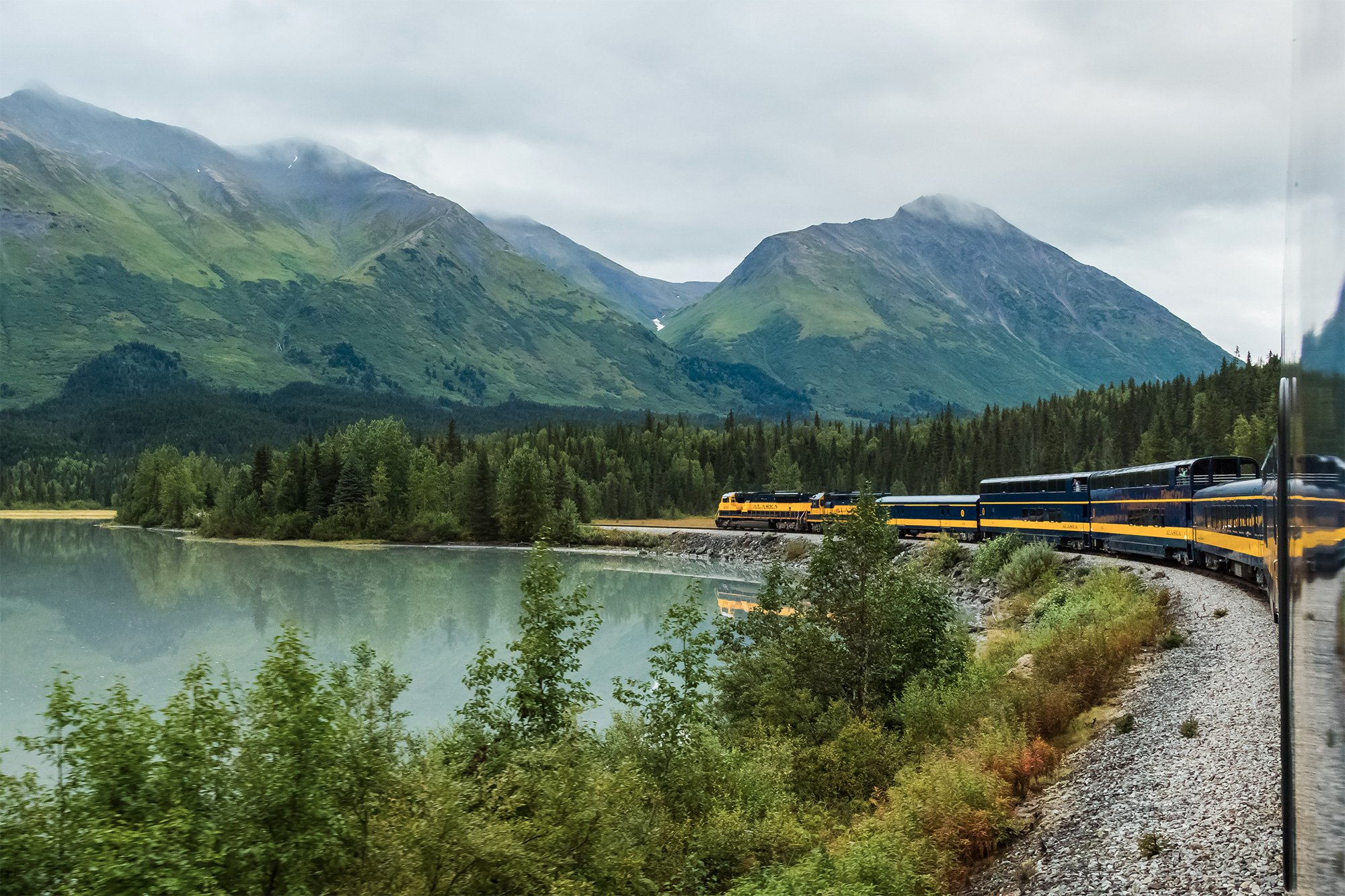 train passing by lake