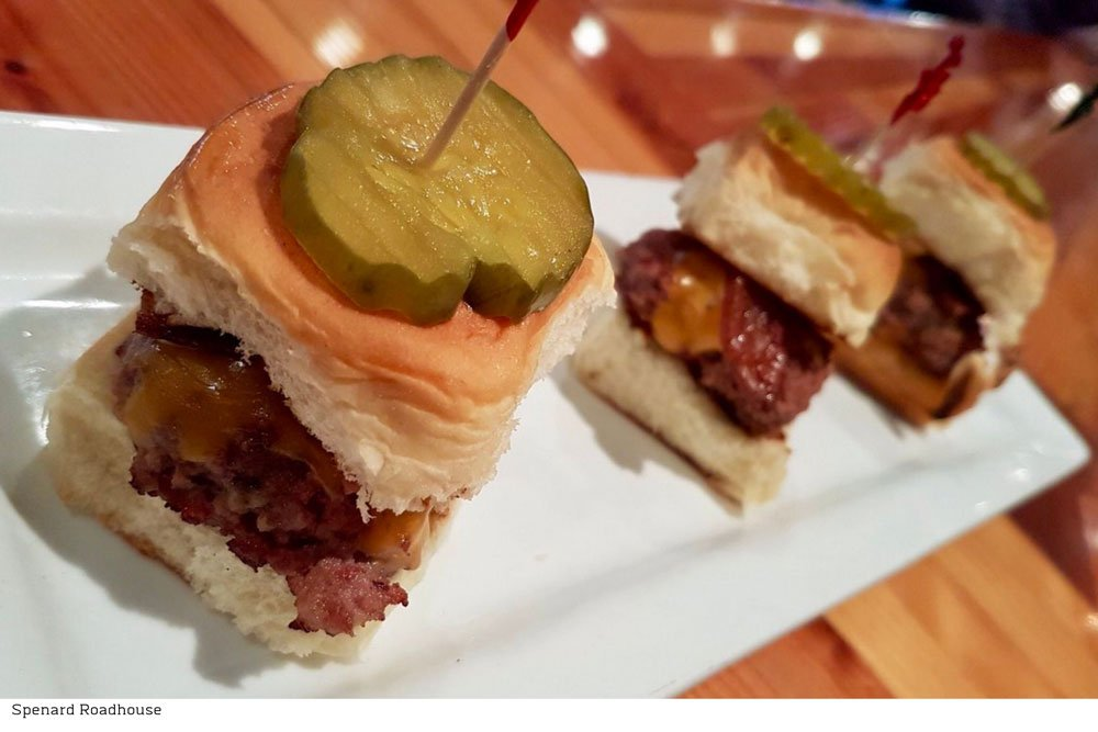 sliders topped with pickle slices