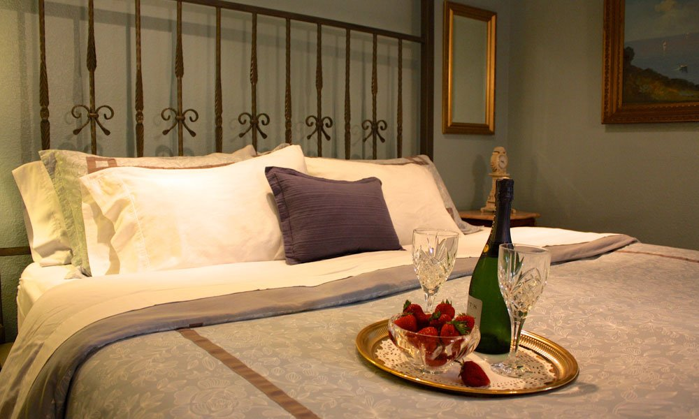 iron bedframe and wine and strawberry tray