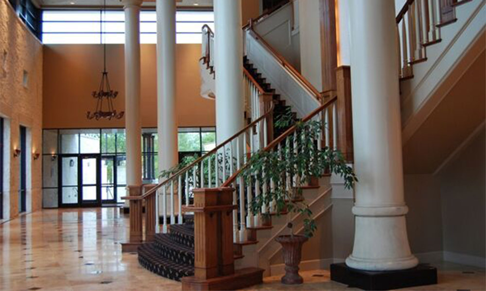 grand staircase with pillars