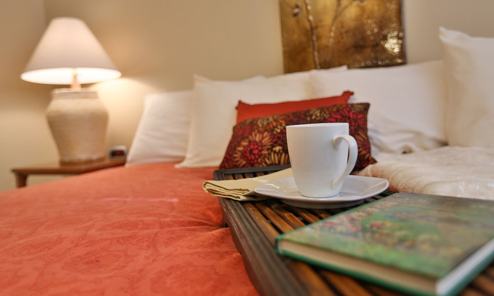 oriental bedspread with teacup