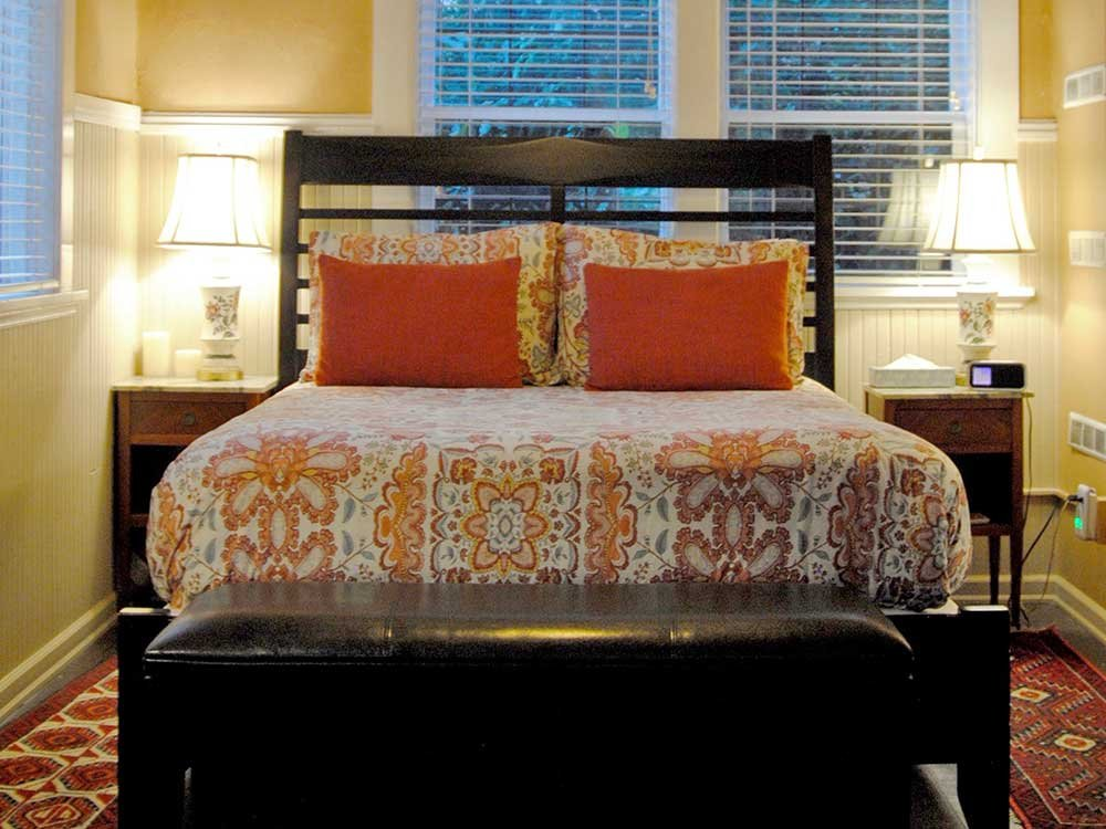 Queen Bed with Orange Pillows